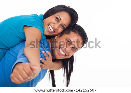 happy young indian couple having fun with piggyback on white background - stock photo