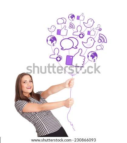 Happy young lady holding social icon balloon - stock photo