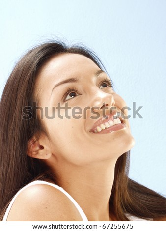 Happy young latin woman looking the sky. - stock photo