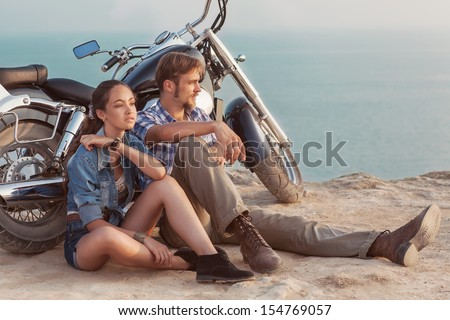 Happy young love couple on scooter enjoying themselves on trip  - stock photo