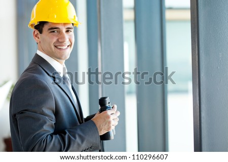 happy young male architect with binoculars - stock photo