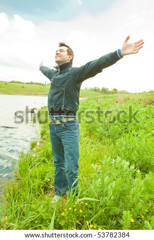 Happy young man - stock photo