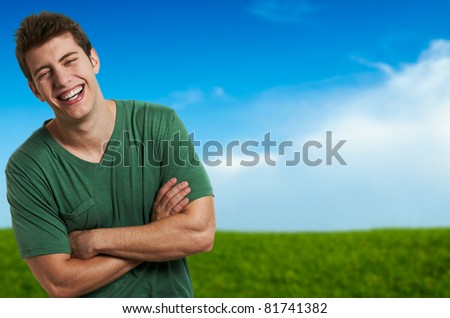 Happy young man at outdoor summer day - stock photo