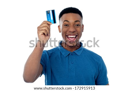 Happy young man displaying his cash card - stock photo