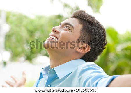Happy young man enjoying outside - stock photo