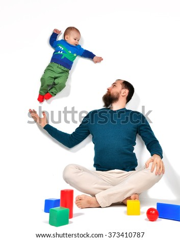 Happy young man father holding flying 5 months old infant child baby on white background - stock photo