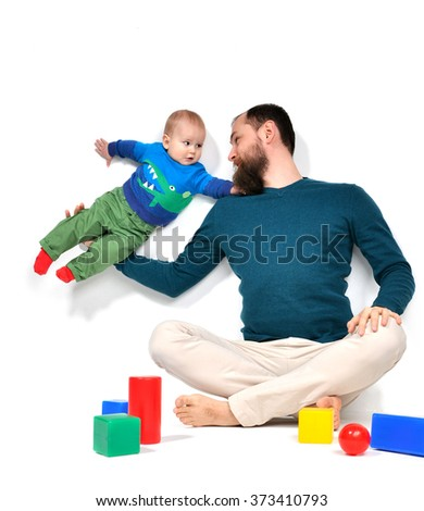 Happy young man father holding his son 5 months old infant child baby on white background - stock photo