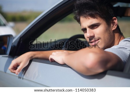 Happy young man going on vacations - stock photo