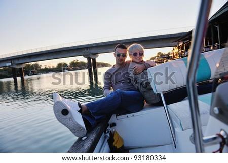 happy young man have fun at boat at sunset on summer season - stock photo