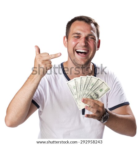 Happy young man holding a pile of cash isolated on white background - stock photo