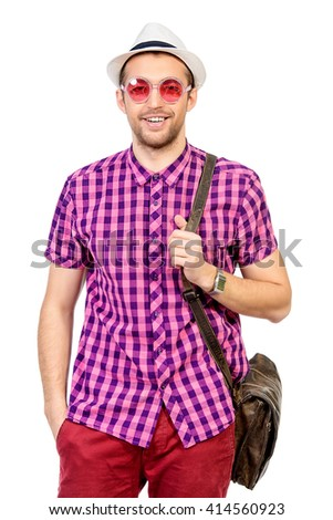Happy young man in stylish bright clothes having fun. Summer fashion. - stock photo