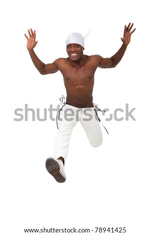 Happy young man jumping against isolated white background - stock photo