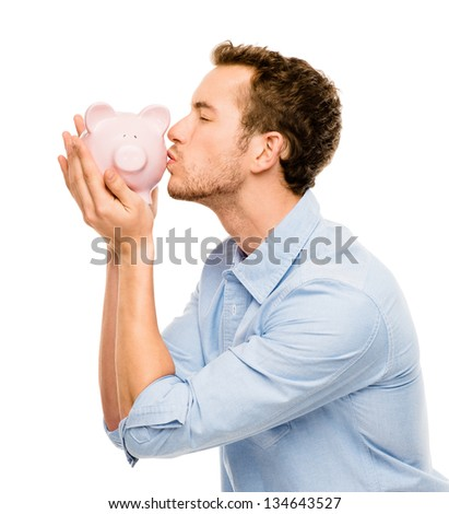 Happy young man kissing piggy bank isolated on white - stock photo