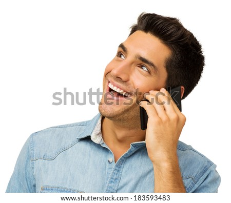 Happy young man looking away while using smart phone against white background. Horizontal shot. - stock photo