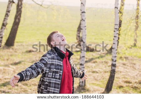 happy young man outdoor - stock photo