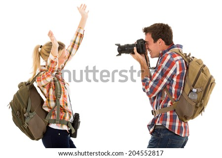 happy young man photographing his girlfriend isolated on white - stock photo