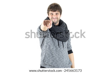 happy young man pointing forward - stock photo