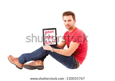 Happy young man presenting your product in a tablet computer - stock photo