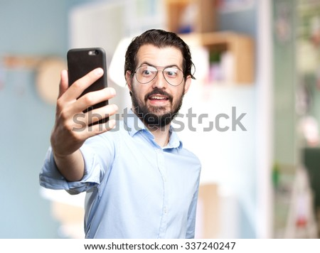 happy young man selfie - stock photo