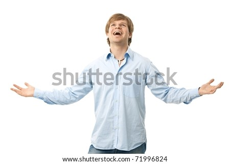 Happy young man standing with arms wide open, laughing. Isolated on white.? - stock photo