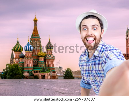 Happy young man taking a selfie photo in Moscow, Russia - stock photo