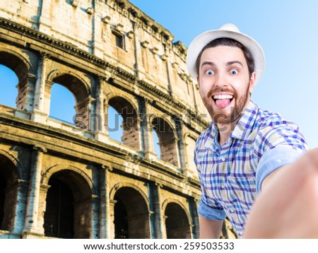 Happy young man taking a selfie photo in Rome, Italy - stock photo