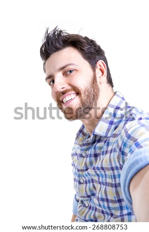 Happy young man taking a selfie photo isolated on white background - stock photo