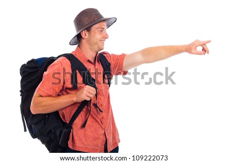 Happy young man traveling with backpack pointing the way, isolated on white background with large copy space. - stock photo