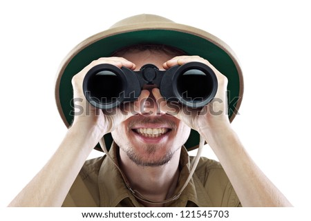 Happy young man wearing safari shirt and pith helmet looking through binoculars, isolated on white, close-up - stock photo