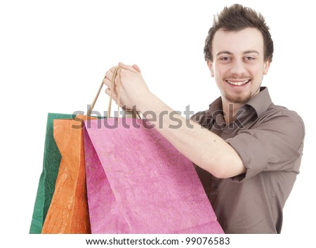 happy young man with coloured shopping bags, white background - stock photo