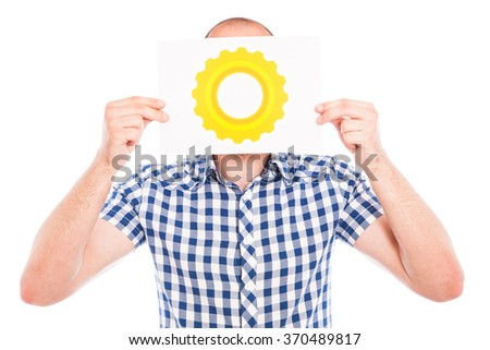 Happy young man with gear sign against the white - stock photo