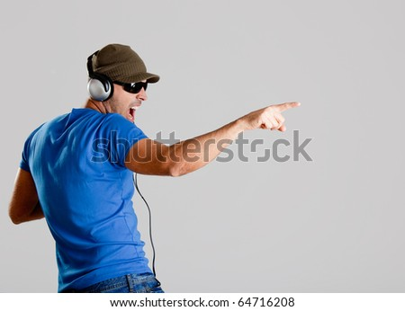 Happy young man with headphones listening music - stock photo