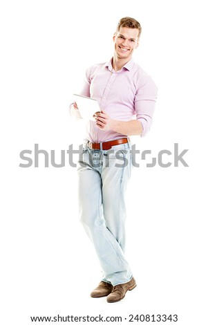 Happy young man with tablet computer - full body isolated - stock photo