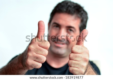 Happy young mature man showing thumbs up.Copy space on white background.real people.Concept photo of success, approval, youth, coolness, positivity,happiness,agreement,confident,friendly,achievement. - stock photo
