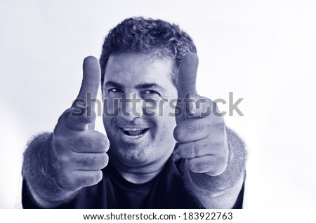 Happy young mature man showing thumbs up.Copy space on white background.real people.Concept photo of success, approval, coolness, positivity,happiness,agreement,confident,friendly,achievement. (BW) - stock photo