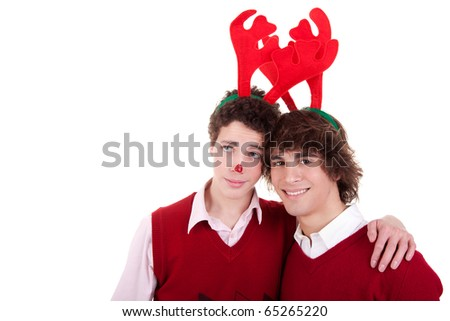 happy young men wearing reindeer horns, on white, studio shot - stock photo