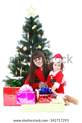 Happy young mother and adorable little daughter in the costume of Santa Claus on the background of the Christmas tree. - Isolated on white background - stock photo