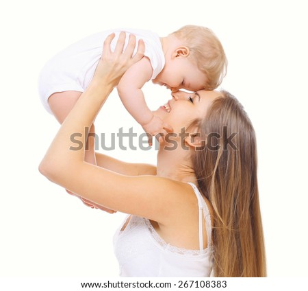 Happy young mother and baby having fun together - stock photo