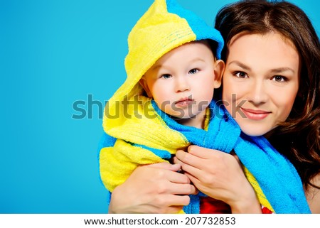 Happy young mother and her adorable son after bath. Healthcare. - stock photo