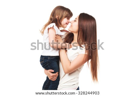 Happy young mother holding her little daughter, smiling together, isolated on white, family concept - stock photo