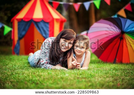 Happy young mother with little daughter outdoor - stock photo