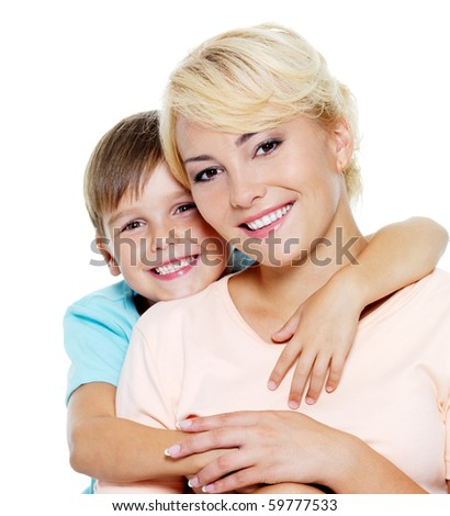 Happy young mother with son of six years. On white background - stock photo