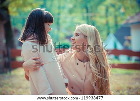 happy young mother with the daughter in park - stock photo