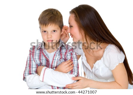 happy young mum cheers sad serious son - stock photo
