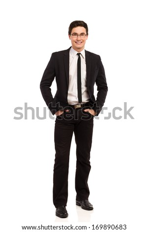 Happy young office worker waiting with hands in pockets. Full length studio shot isolated on white. - stock photo