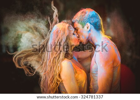 happy young pair in paints holi - stock photo