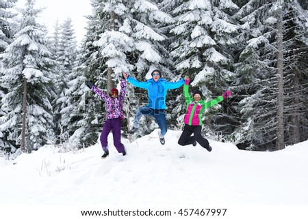 happy young people group have fun and enjoy fresh snow at beautiful winter day - stock photo