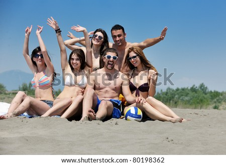 happy young people group have fun  run and jump  on beach beautiful sand  beach - stock photo