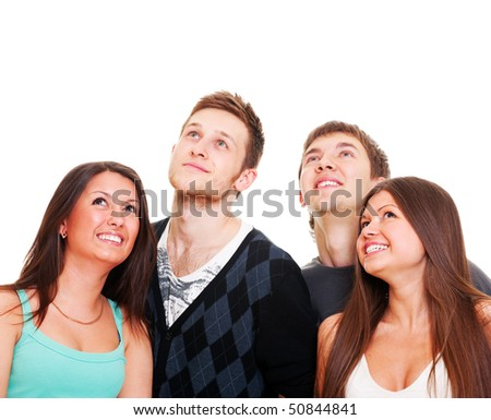 happy young people looking up at something. isolated on white background - stock photo