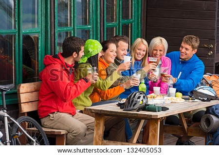 Happy young people resting and drinking beer after biking - stock photo